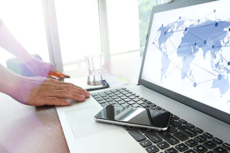 mobile business: Close up of business man hand working on laptop computer with social media diagram and chart graph on wooden desk as concept Stock Photo