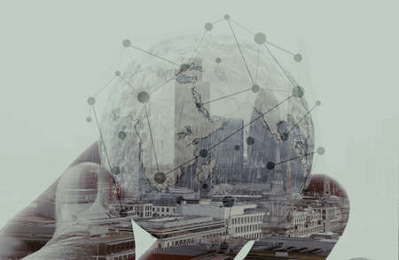 double exposure of businessman hand showing texture the world concept and social network diagram Elements of this image furnished by NASA london city background