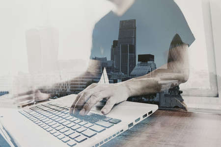building industry: Double exposure of businessman working with new modern computer