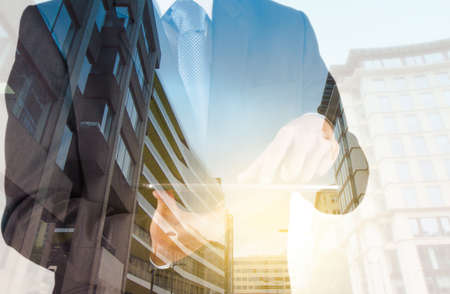 business analysis: Double exposure of success businessman with abstract building