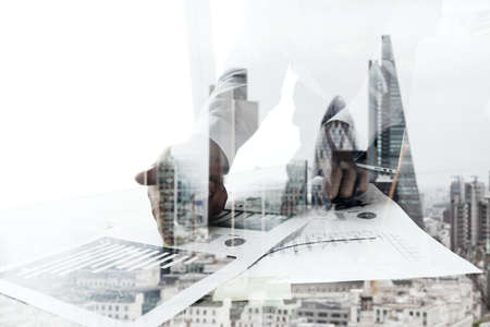 Double exposure of businessman working with new modern computer  and london city blurred background