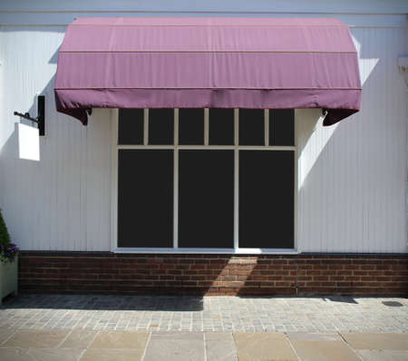 the strip: Shopfront vintage store front with canvas awnings and blank display