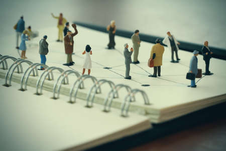 global network: close up of miniature people with social network diagram on open notebook on wooden desk as social media concept