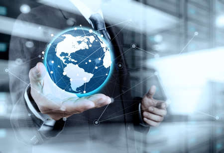 Double exposure of businessman working with new modern computer show globe with social network structure and bokeh exposure Stock Photo