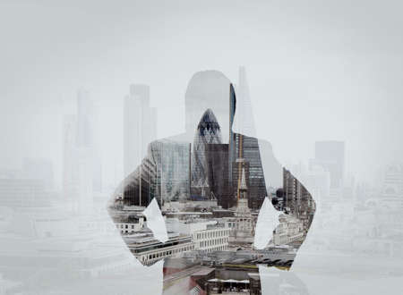 successfully: double exposure of businessman stands successfully on building top Looking Towards the future Stock Photo