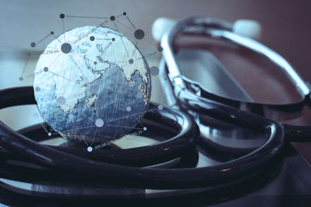 network diagram: stethoscope and texture globe with digital tablet with social media network diagram as medical network concept