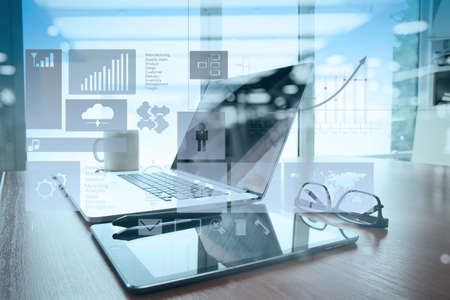 double exposure of Office workplace with laptop and smart phone on wood table with eyeglasses on digital tablet