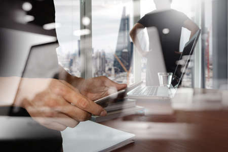 phone business: double exposure of businessman shows modern technology with business strategy as concept Stock Photo