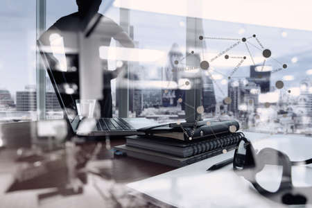 team business: double exposure of business documents on office table with smart phone and digital tablet and london city blurred view and man thinking in the background