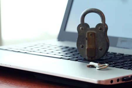 social networking: Internet security concept-old padlock and key on laptop computer keyboard