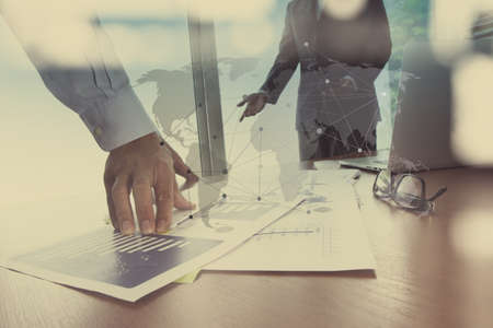 consultants: Double exposure of businessman hand working with new modern computer and business strategy as concept