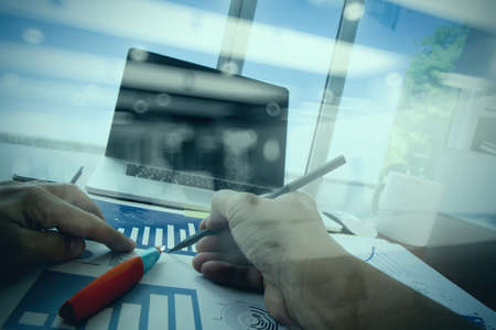 opportunity concept: double exposure of businessman hand working with business documents on office table with laptop computer with social media diagram