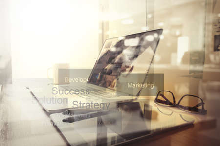 business analysis: business documents on office table with smart phone and digital tablet and graph business diagram and man working in the background