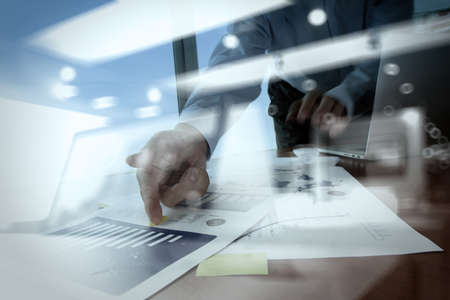 double exposure of businessman hand working with business documents on office table with laptop computer with social media diagram