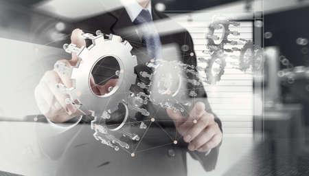 engranajes: doble exposición de las artes de la mano de negocios humano espectáculo para el éxito como concepto con el diagrama de la red