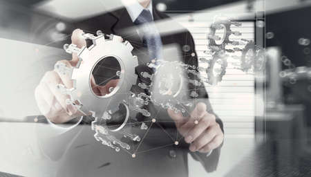 double exposure of businessman hand show human gear to success as concept with network diagram