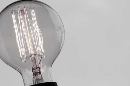creative concept: close up of vintage light bulb as creative concept Stock Photo