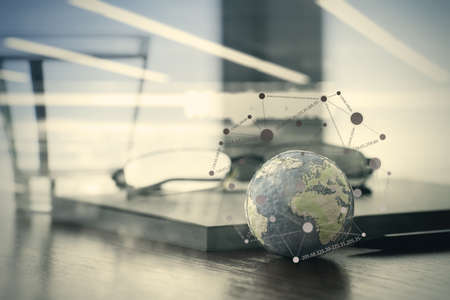 making earth: double exposure of hand drawn texture globe with social media diagram on wood table near note book and glasses