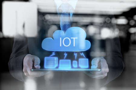 objects: double exposure of hand showing Internet of things (IoT) word diagram as concept Stock Photo