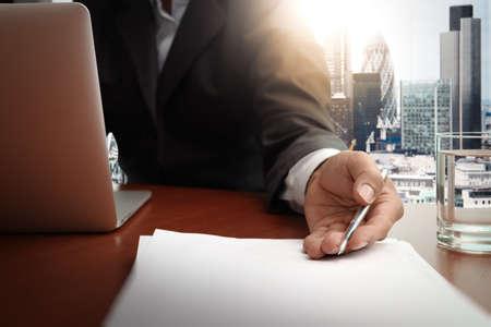 handing over: double exposure of businessman or salesman handing over a contract on wooden desk Stock Photo