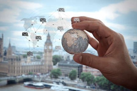 connects: close up of businessman hand showing texture the world with digital social media network diagram concept  Stock Photo