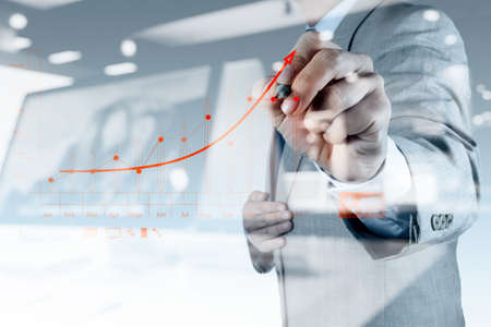 finance manager: double exposure of businessman hand drawing virtual chart business on touch screen computer Stock Photo