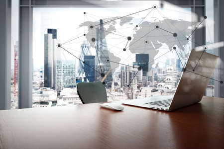 Office workplace with laptop and smart phone on wood table with london city background with social media diagram Stockfoto