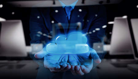 double exposure of Businessman hand working with a Cloud Computing diagram on the new computer interface as concept
