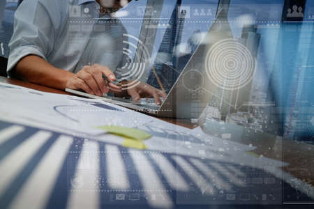 innovations: businessman hand working with modern technology and digital layer effect as business strategy concept