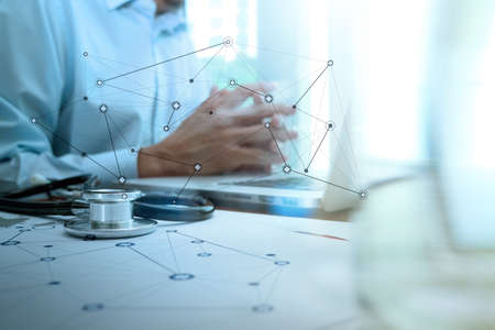 medical doctor: Doctor working with digital tablet and laptop computer in medical workspace office and medical network media diagram as concept