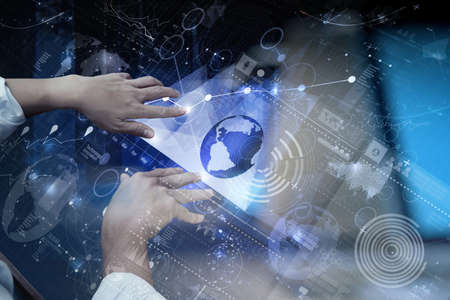 security technology: top view of businessman hand working with modern technology and digital layer effect as business strategy concept Stock Photo