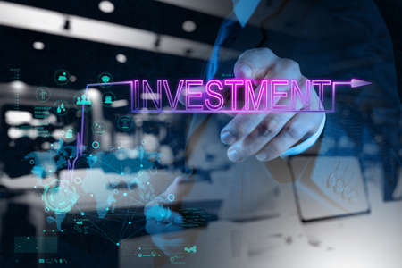 investment concept: double exposure of businessman hand pointing to investment diagram as concept Stock Photo