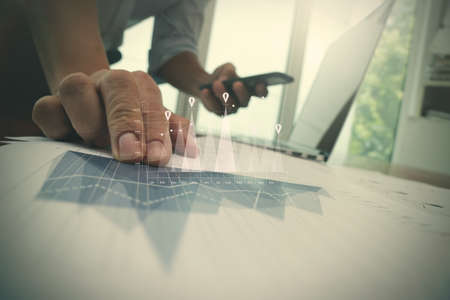 project management: Double exposure of businessman hand working with new modern computer and business strategy as concept