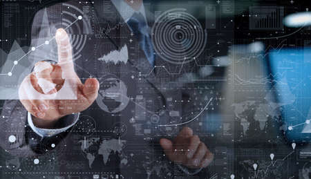business security: businessman hand working with modern technology and digital layer effect as business strategy concept