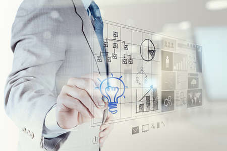 invent clever: Double exposure of businessman hand draws lightbulb with new computer interface as solution business concept Stock Photo