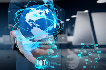 mobile internet: double exposure of hand showing Internet of things (IoT) word diagram as concept Stock Photo