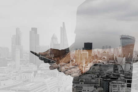 project management: Double exposure of success businessman using digital tablet with london building and social media diagram