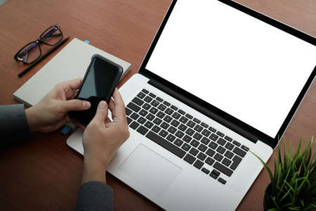 interactivity: top view of businessman hand using on smart phone and laptop computer as concept Stock Photo