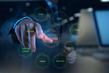 implement: Double exposure of businessman hand shows diagram of business success chart as concept Stock Photo