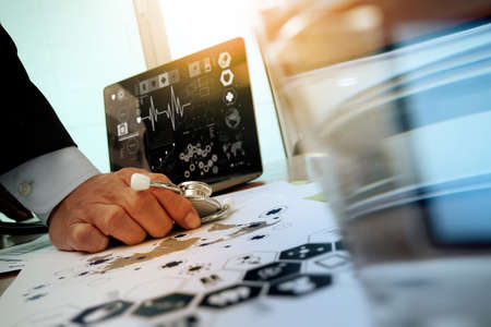 health care: doctor working with laptop computer in medical workspace office and medical network media diagram as concept Stock Photo