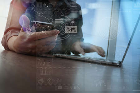 business in hand: Double exposure of businessman hand working with mobile phone and modern computer and business strategy as concept Stock Photo