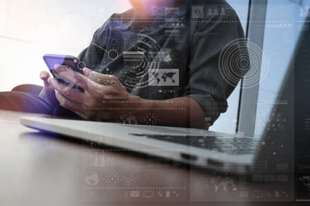 Double exposure of businessman hand working with mobile phone and modern computer and business strategy as concept Standard-Bild