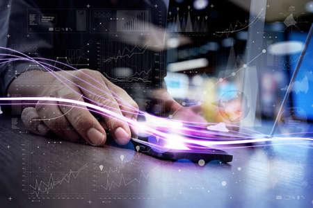 青い光とデジタル レイヤー効果を持つスマート フォンに使用して概念としてビジネスマンの波 写真素材