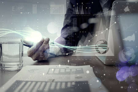 Waves of blue light and businessman using on laptop computer with digital layer effect  as concept Stock Photo