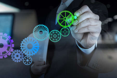 cog gear: Double exposure of businessman hand draw leader cog gear to success concept Stock Photo