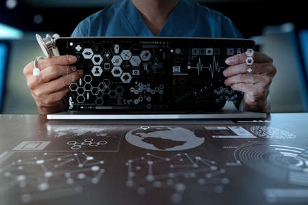 medicine symbol: Medicine doctor hand working with modern computer interface as medical network concept Stock Photo