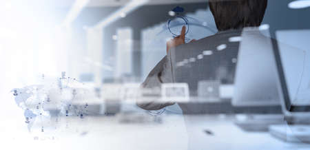 business media: double exposure of businessman working with modern technology as concept Stock Photo