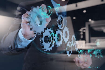 group solution: double exposure of businessman hand working with cog gear to success as concept Stock Photo