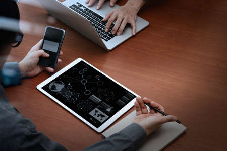 Online Business: top view of businessman hands using digital pro tablet and smart phone with Secure payment on the screen as Online shopping concept