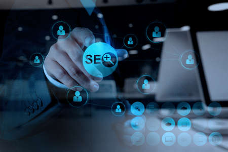 seo concept: double exposure of businessman hand showing search engine optimization SEO as concept